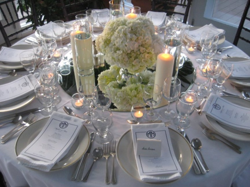 Wedding floral and candle centerpieces at Gasparilla Inn, Boca Grande