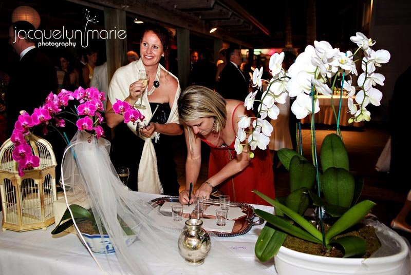 Wedding flowers on sign-in table at Boca Grande wedding reception