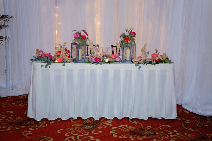Sweetheart tables with Lanterns and Flowers