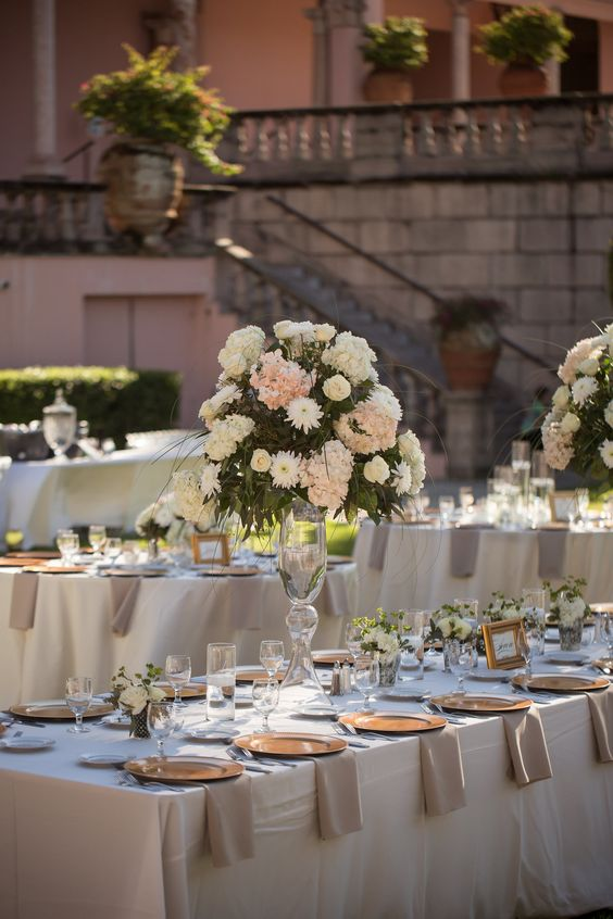 Guest Tables with Elevated Centerpieces and votives