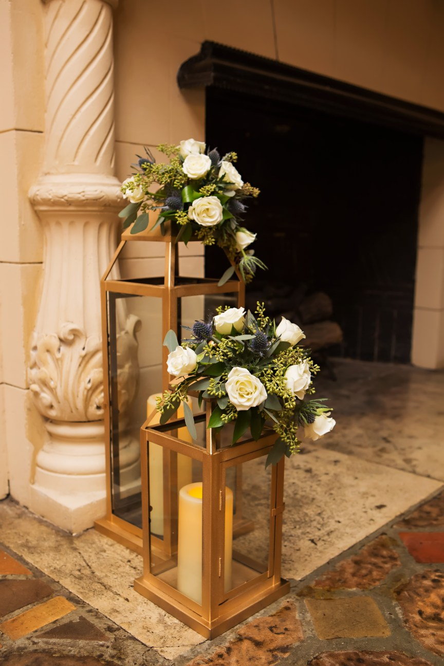 Repurposed Lanterns with Flowers from Ceremony Moved to Loggia Reception Site