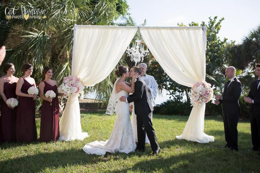 First Kiss at Ceremony Arch