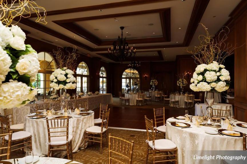 Gorgeous All-White Guest Table Centerpieces in Reception Ballroom
