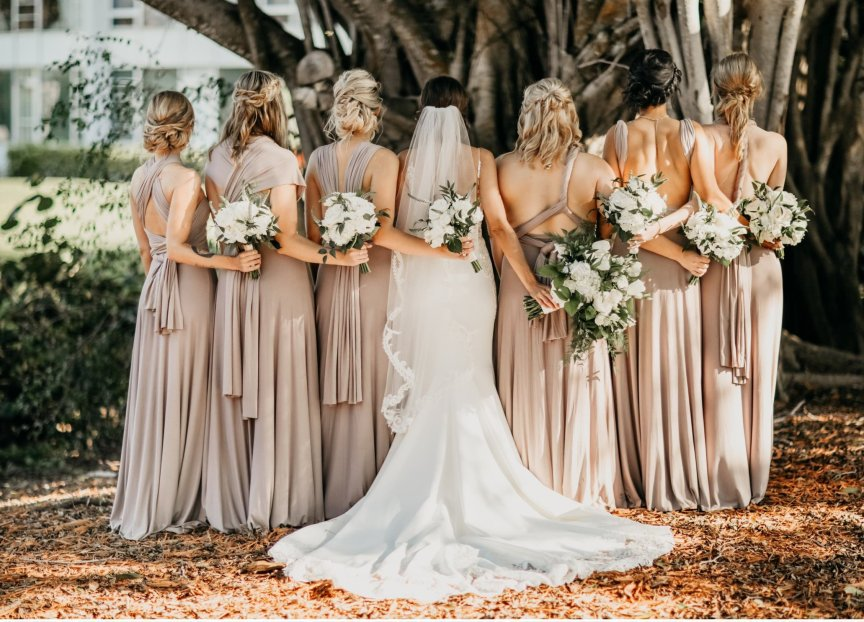 Bride and Bridesmaids with Bouquet Longboat Key Club Wedding All-White Flowers