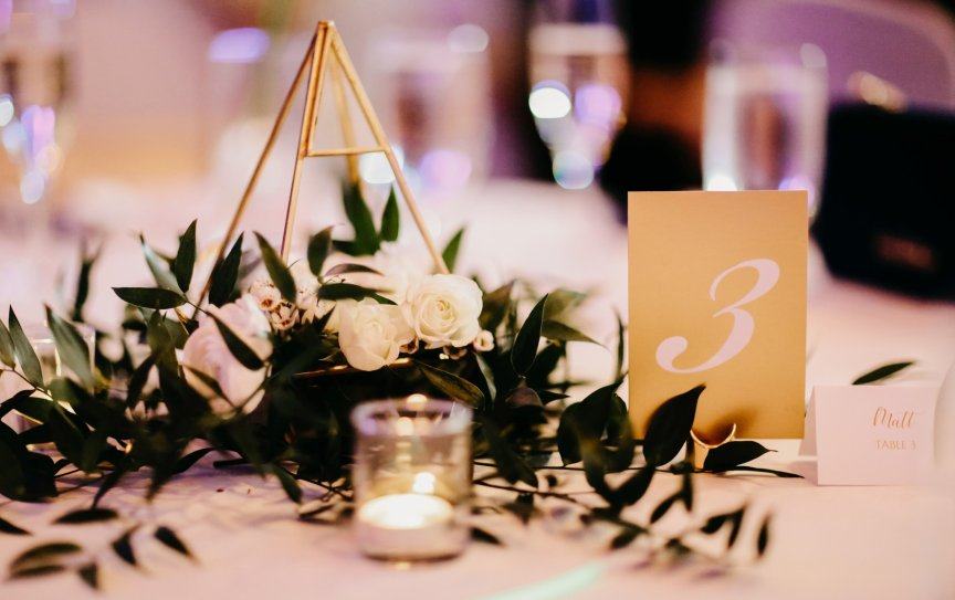 Gold Geometric Guest Table Centerpieces with Roses , Greenery, and Candles