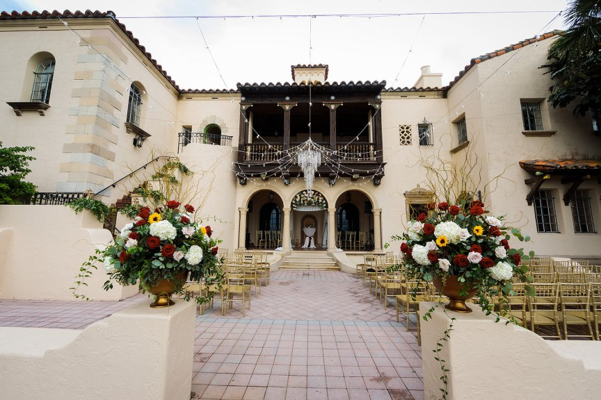 Ceremony Site with Large Flower Arrangements in Gold Urns