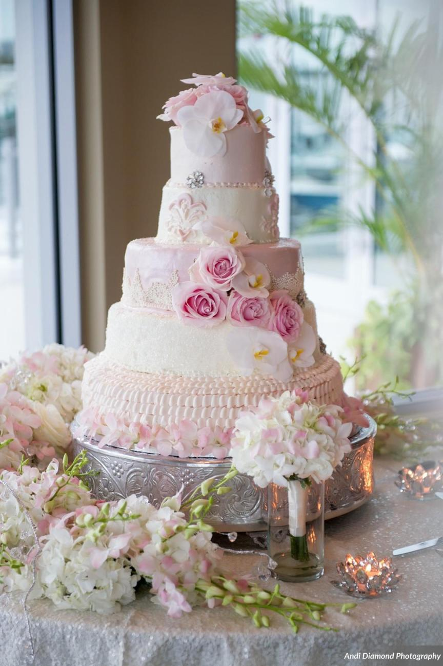 Beautiful Wedding Cake with Flowers and Toss Bouquet