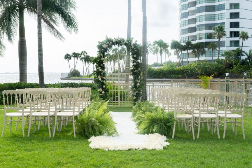 Close Up of Ceremony Site with Floral Arch, Iron Gate, White Runner, and Ferns