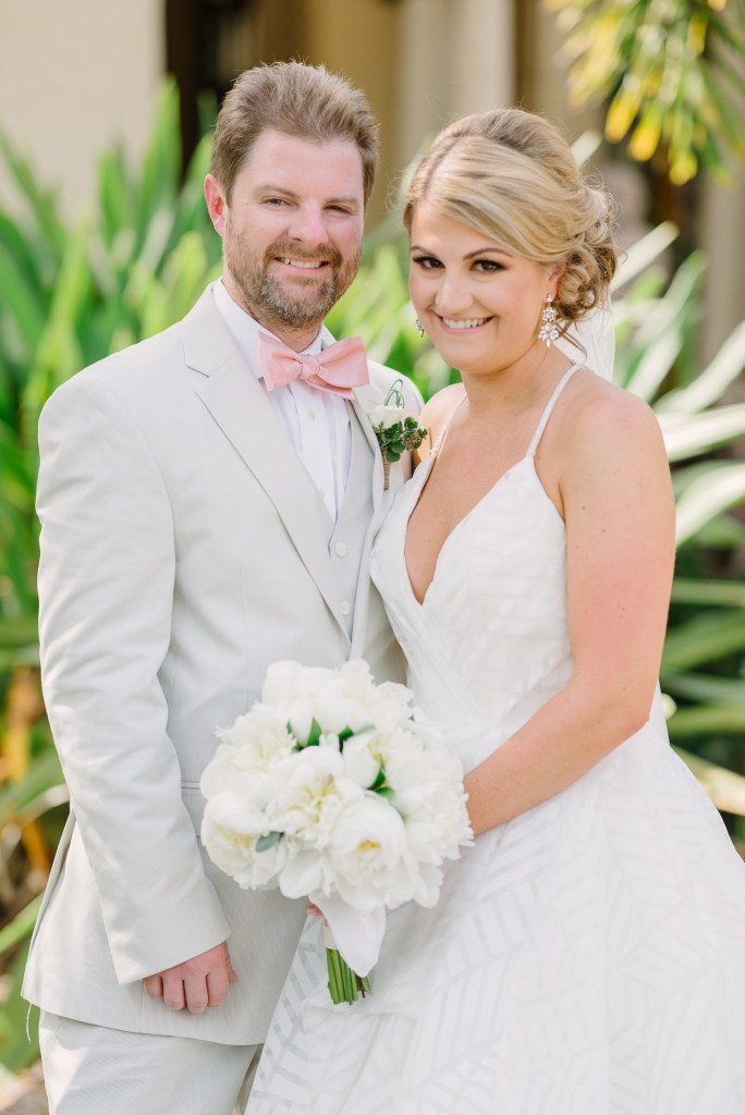 Groom and Bride with All-White Bridal Bouquet