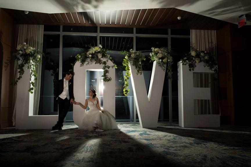 Bride & Groom in Front of Love sign