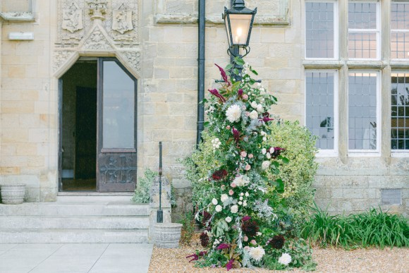 Moveable lamppost arrangement at Balcombe Place. Budgeting for your wedding flowers.