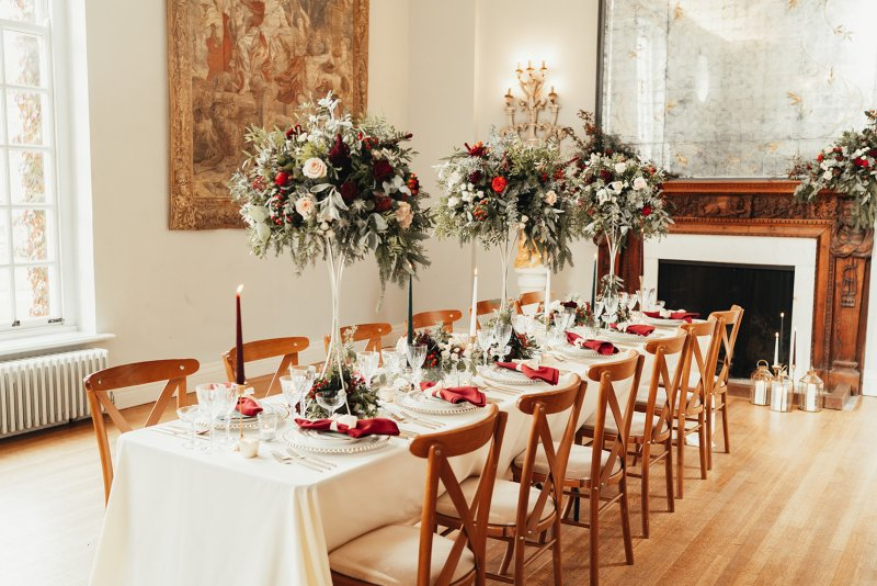 Autumnal set up with tall flower arrangements. Wedding Flower centrepieces.