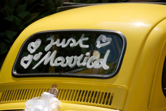 decorate newlyweds' car - just married written on back window of car
