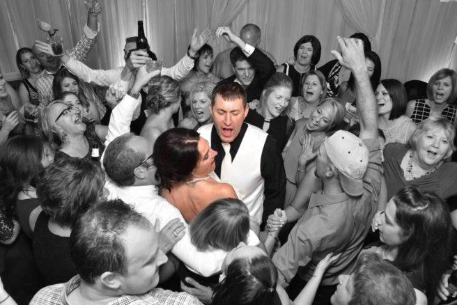happy guests with bride & groom