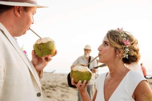 bride groom beach coconut drinks
