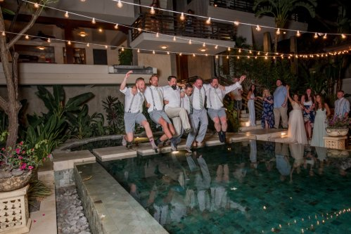 weddings-costa-rica-groom-jumping-in-pool