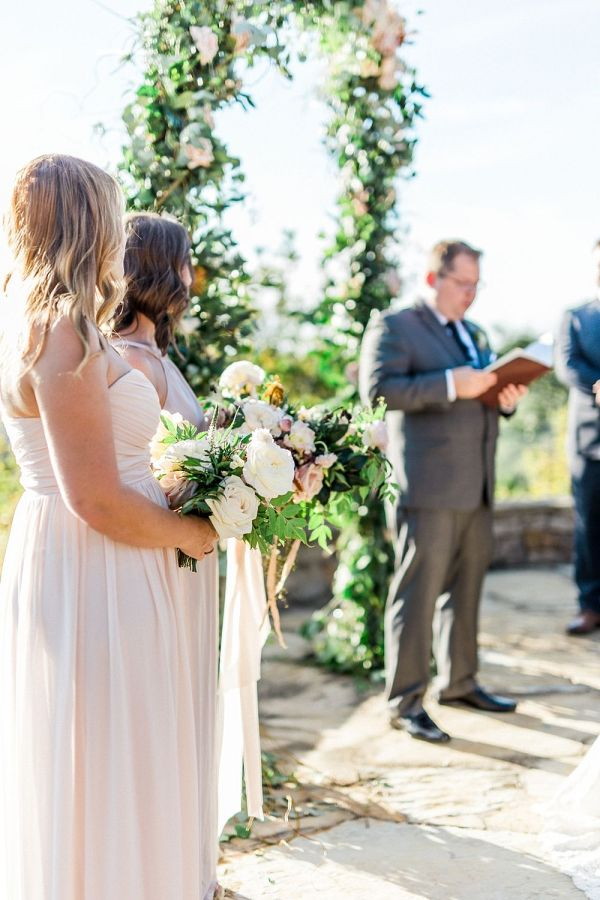 Erin and Joshs Texas Wedding with a Floral Arbor by
