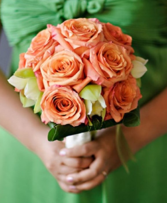 Green Brides maids dress with Coral Orange Bridesmaids bouquet