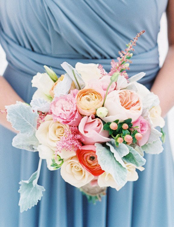 Light Blue brudesmaids dress with orange white and pink bridesmiads bouquet