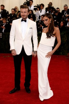 Victoria Beckham in her own design and Jacob & Co. jewellery with David Beckham