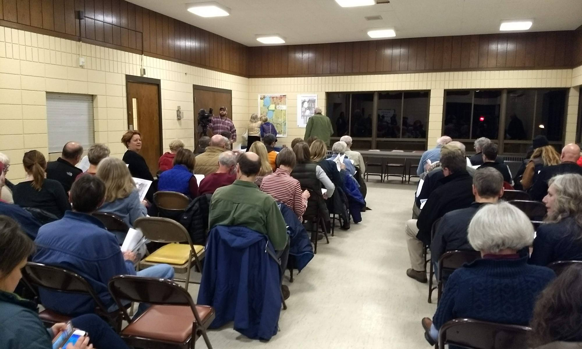 Crowd shot of older residents at Linden Hills comprehensive plan meeting featuring Council Member Linea Palmisano.