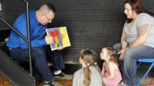 Phil shares Gospel with girls at Easter outreach