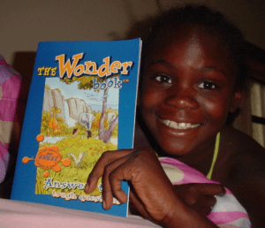 We provide CEF Press Wonder Devotional Books to children through your donations. (picture, (c) Child Evangelism Fellowship