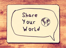 vintage-board-phrase-share-your-world-written-retro-filtered-image-44411996