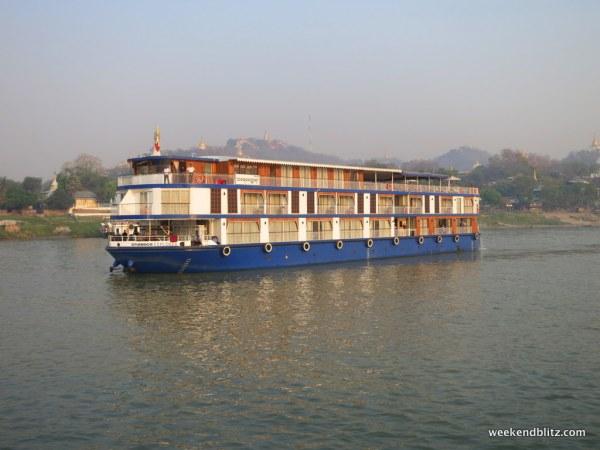Cruise boat with overnight cabins headed towards Mandalay