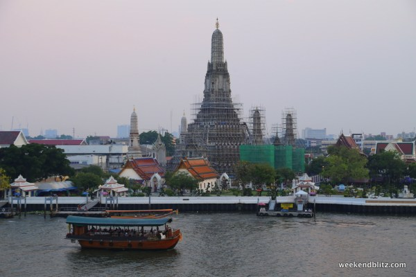 The views of Wat Arun from Eagle Nest's rooftop deck