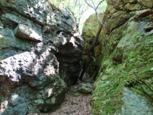 narrow path between two vertical rock faces