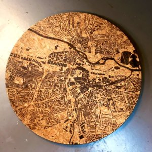 """Reading map"" etched cork tray showing only buildings and rivers by Tony Short"