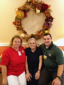 Pictured: Angel Mehalic (Burton Heath Care Center Director of Nursing), Katharina Way (Burton Health Care Center Resident) and Dr. Neely.
