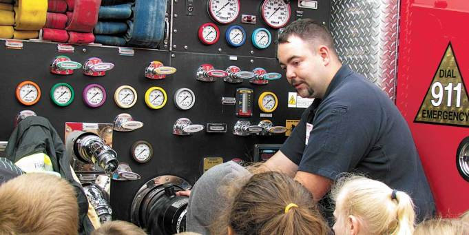 Lieutenant Brooke Stamm and Firefighter Jerod Holtzman helped kids participate in special kid-friendly drills. For instance, to learn how to safely escape a fire's harmful smoke