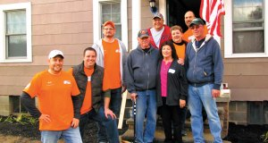 Team Depot -- Home Depot Volunteers including District Manager Jeff Miller, Team Depot District Captain Chris Schigel, Merchandise Manager Paul (with wife Hillary) Onuska, and Store Manager Jason Eidam, along with local volunteers Ronnie Kotkowski and Linda Elhert, surround local veteran Bud Foster.