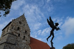 "The statue is ""Angel with trumpet"" by Carl Milles in front of Sankt Nicolai Church in Simrishamn."