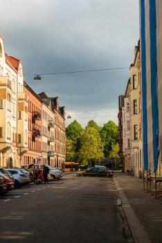 Sun but the sky still looks threatening on Sturegatan in Rörsjöstaden.