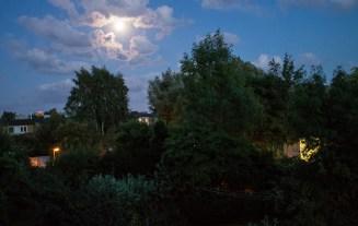 A bright night sky night before super moon.