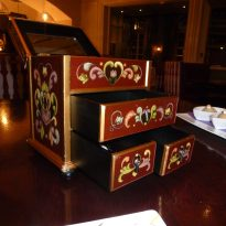 Small containers with drawers contained chocolates and other goodies at the end of the meal.