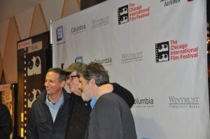 Michael Moore and producers on the Red Carpet on Oct. 23 in Chicago.