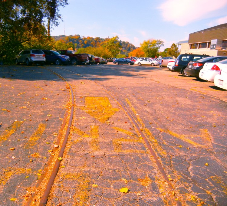 Parking lot along South St.; Wesbanco Arena top right, railroad tracks still embedded. (Photo - Rich Knoblich)