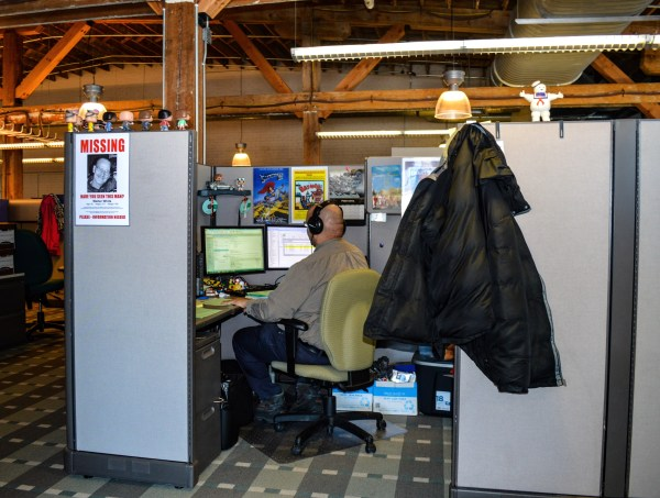 Orrick employee Bryan Hinton works in an area very typical of what is offered inside the firm's global operations center.