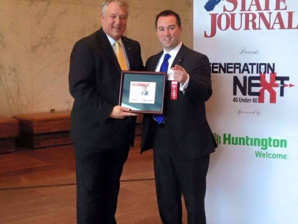 """Del. Fluharty was named to the State Journal's """"40 Under 40"""" statewide listing, and accepted the honor from Senate President William Cole."""