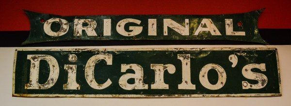 This sign hung for years in downtown Wheeling at a few other locations. Today, it hangs inside the office of the downtown Wheeling store.