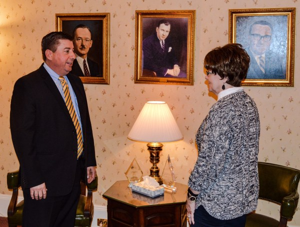 Fahey speaks with Altmeyer's Linda Orr at the funeral home on 14th Street.