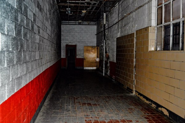 """This hallway is where the legendary """"Shadow Man"""" was photographed a few years ago. ... Is that an orb? Because it's not a dusty camera lens."""