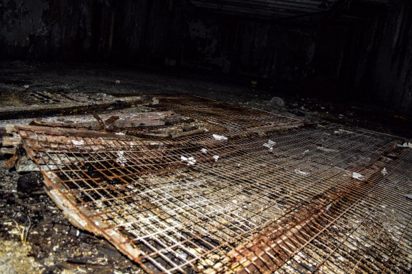 Vandals have dismantled the cages that once held patients after the facility became an insane asylum.