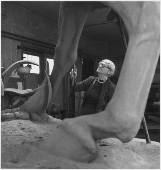 Anna Hyatt Huntington sculpting a statue of Cuban hero Jose Marti.