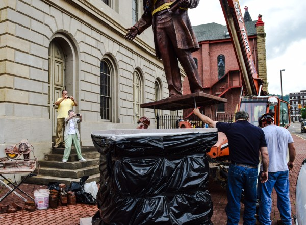 The cameras were out as employees of Walter Construction prepared to install the statue of Francis Pierpont.