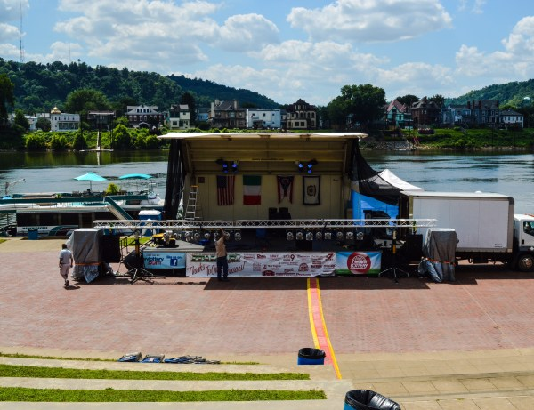 Crews work Friday on setting up the festival's main stage at the base of Heritage Port.
